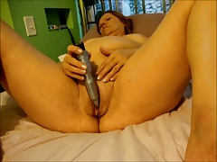 Big granny masturbating on..