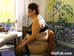 Busty mature fatty gets her..