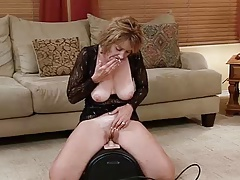 Hot Mature Rides Sybian.....