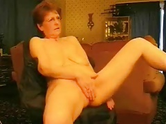Hot granny rubbing the brush..